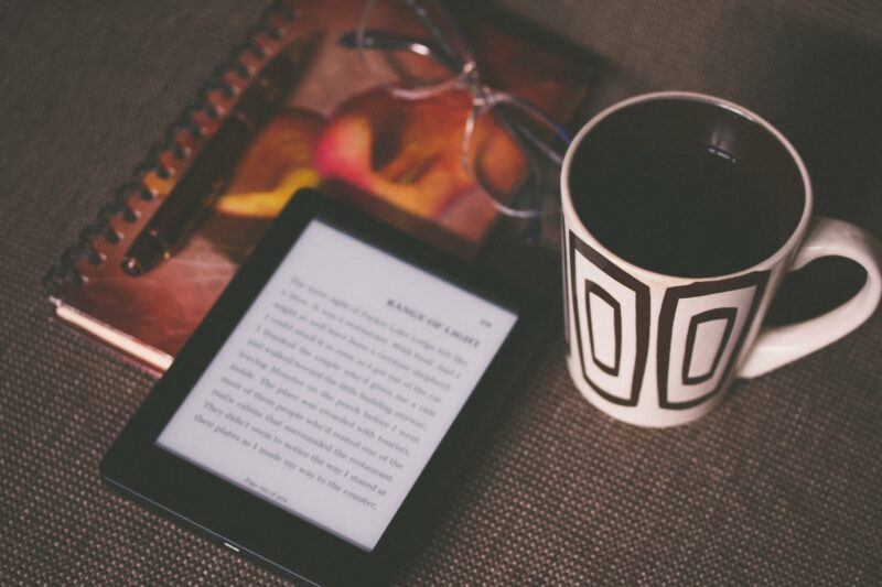 Kindle reading and coffee cup